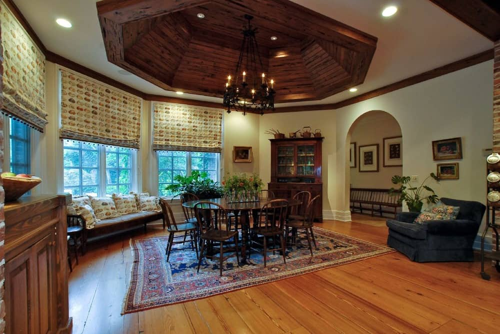 Another dining area featuring a round dining table set on top of an area rug covering the hardwood flooring. Images courtesy of Toptenrealestatedeals.com.