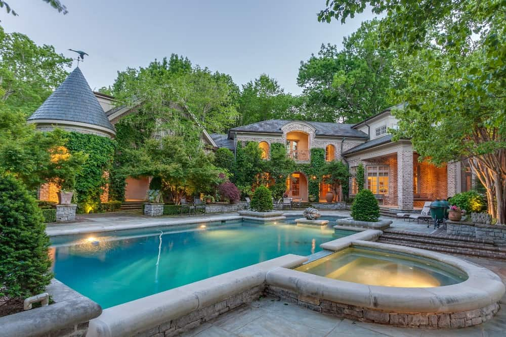 The outdoor area boasts amenities such as a swimming pool with lighting and has a jacuzzi area. Images courtesy of Toptenrealestatedeals.com.