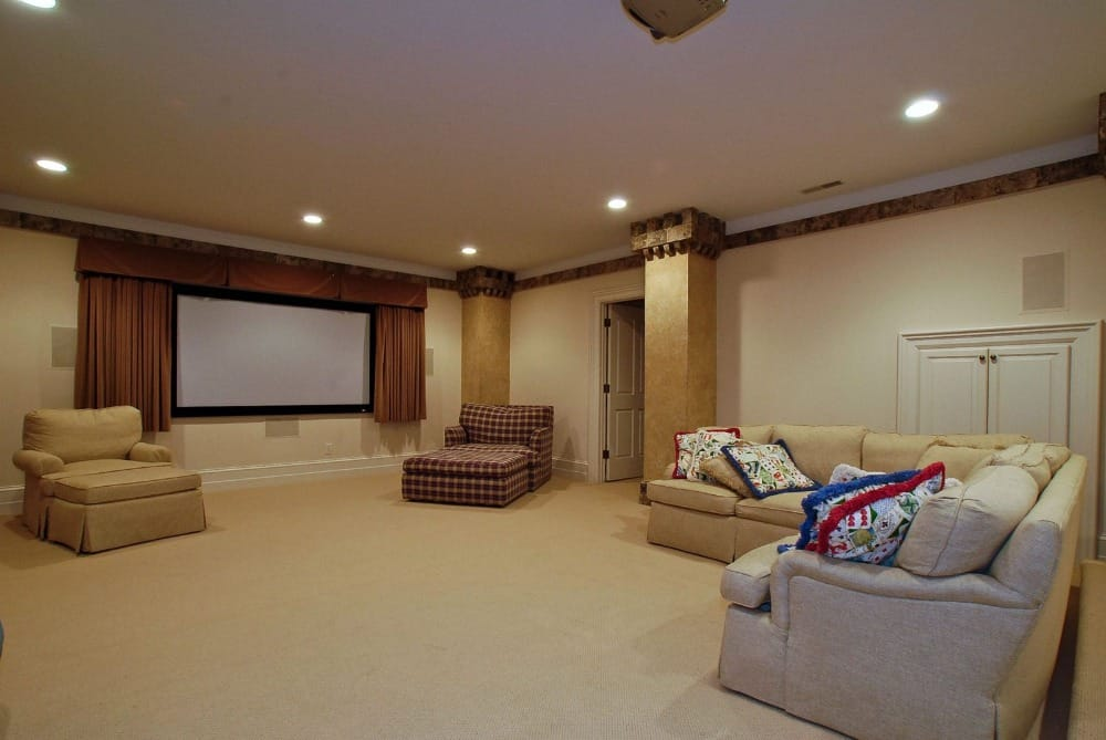 There's also a spacious home theater in the mansion offering comfy seats and a theater-style TV. Images courtesy of Toptenrealestatedeals.com.
