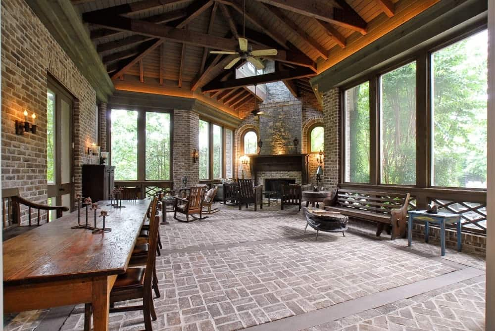 The great room offers a living space with a fireplace along with a wooden rectangular dining table set. Images courtesy of Toptenrealestatedeals.com.