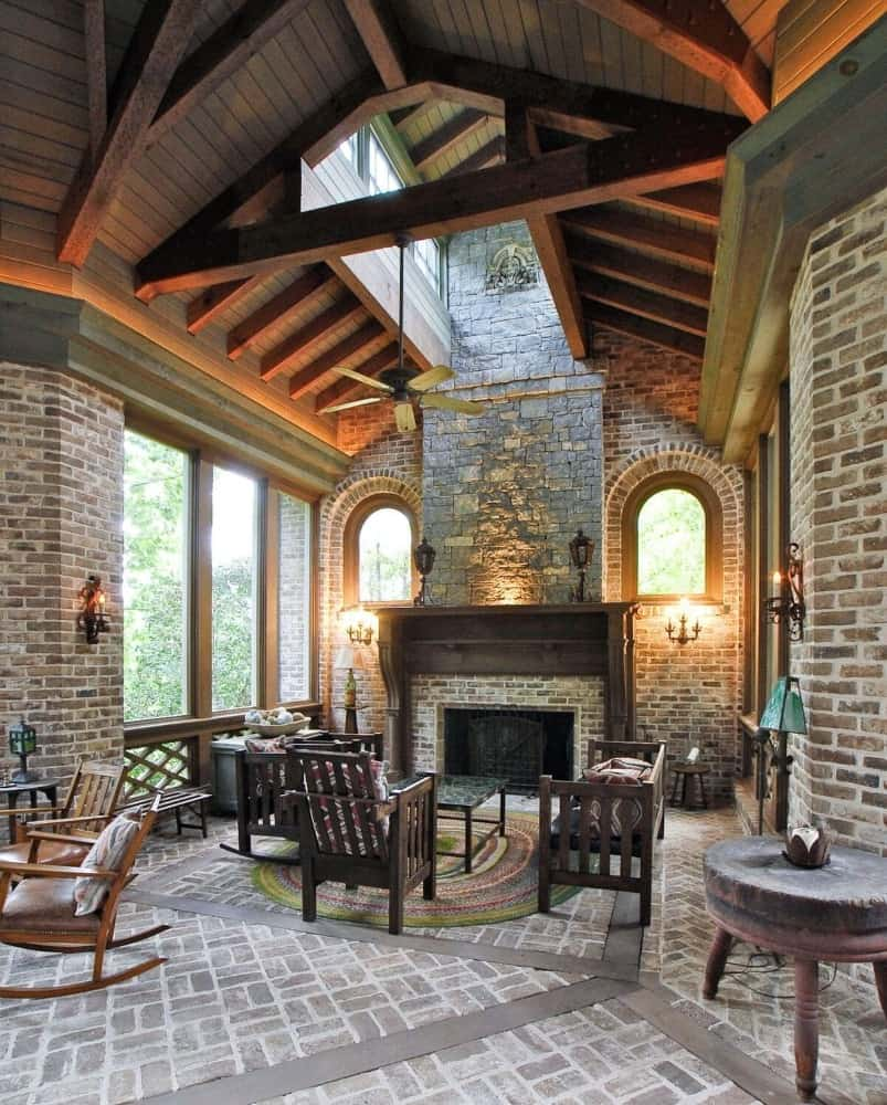 This living space is part of a great room. It offers a nice wooden set of seats and a fireplace. Images courtesy of Toptenrealestatedeals.com.