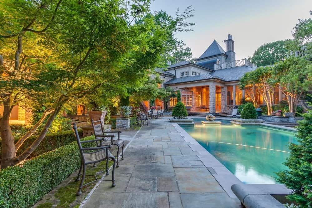 Here's the walkway on the side of the swimming pool where multiple seats are set. Images courtesy of Toptenrealestatedeals.com.