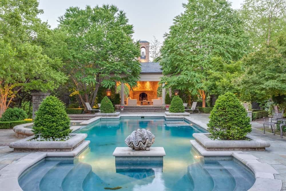 A focused look at the mansion's classy swimming pool with landscaping plants on its four corners. Images courtesy of Toptenrealestatedeals.com.