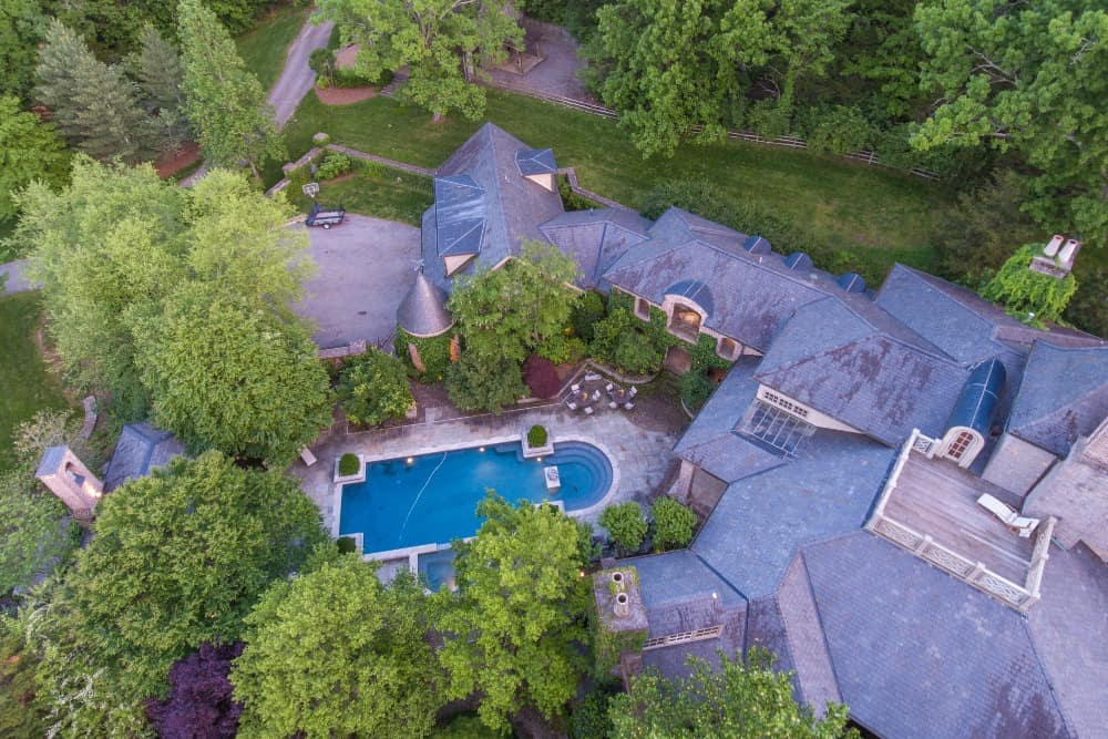 Aerial view of the mansion showcasing its outdoor amenities such as the swimming pool. Images courtesy of Toptenrealestatedeals.com.