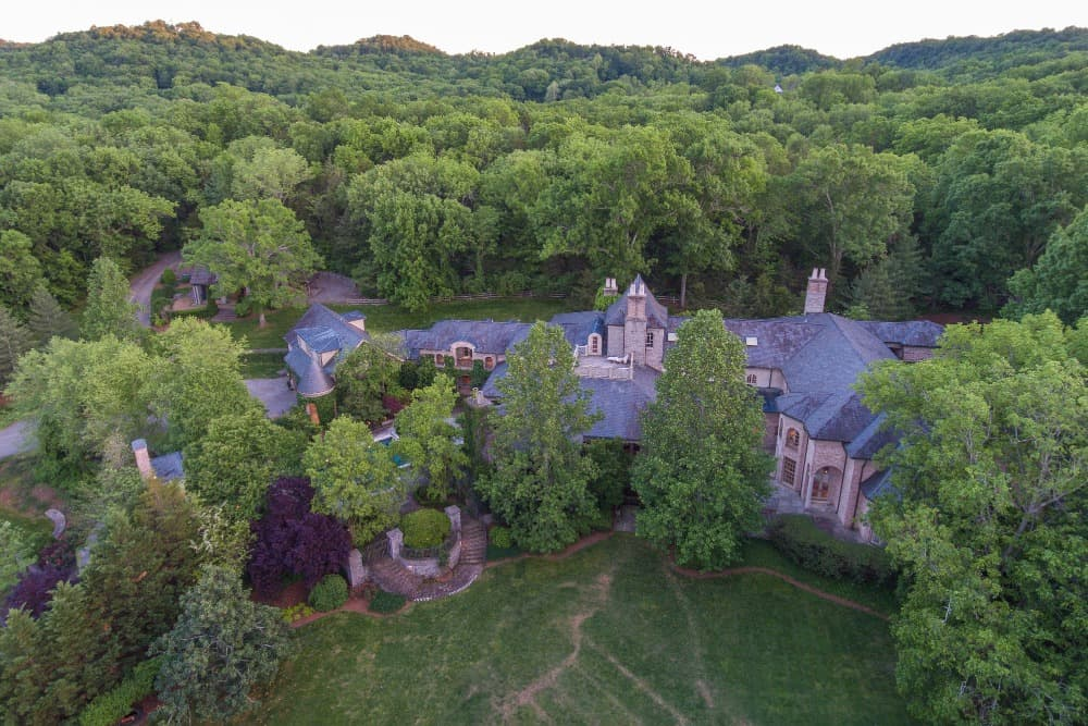 This aerial view showcases the mansion's gorgeous landscaping and lawn area. Images courtesy of Toptenrealestatedeals.com.