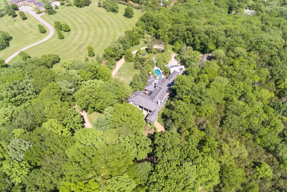 This aerial view showcases the whole property surrounded by the lush greenery. Images courtesy of Toptenrealestatedeals.com.