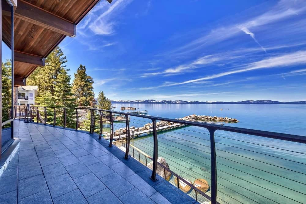 The balcony is quite long and has modern railings. From the balcony, the sea and the mountain range can be clearly seen. Images courtesy of Toptenrealestatedeals.com.