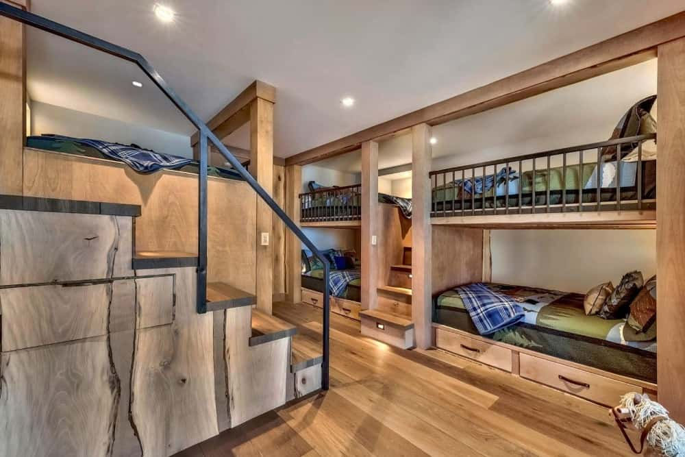 This kids' bedroom offers two sets of bunk beds with a staircase in between them. Images courtesy of Toptenrealestatedeals.com.