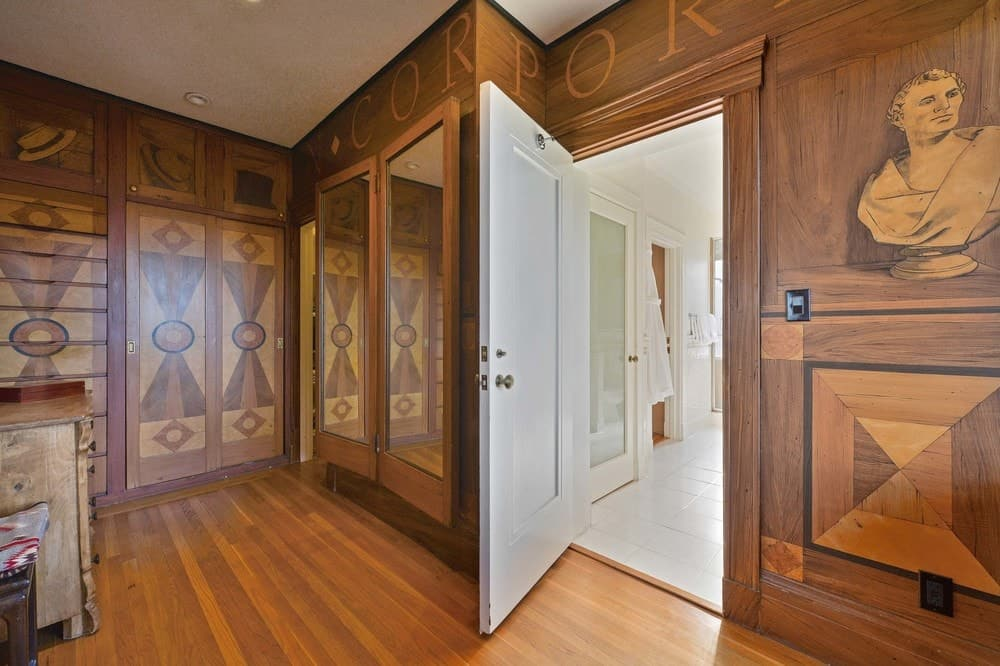 This is the walk-in closet that has gorgeous wooden structures built into the walls matching with the earthy tone of the hardwood flooring. These cabinets have mirrored doors while some have charming stained wooden designs. Images courtesy of Toptenrealestatedeals.com.