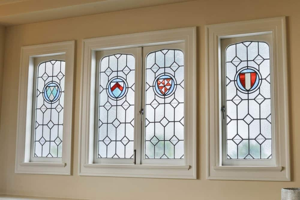 This is a close up of the row of stained glass windows that filter the natural light coming into the room with its frosted surface adorned with elegant designs. Images courtesy of Toptenrealestatedeals.com.