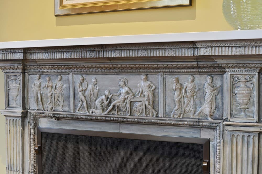 This is close-up view of the gray mantle of the fireplace. It has minute carvings and details that takes its beauty to a whole new level. Images courtesy of Toptenrealestatedeals.com.