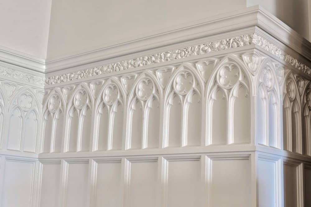 This is close-up view of the lovely details and craftsmanship applied to the wainscoting lining the walls. Images courtesy of Toptenrealestatedeals.com.