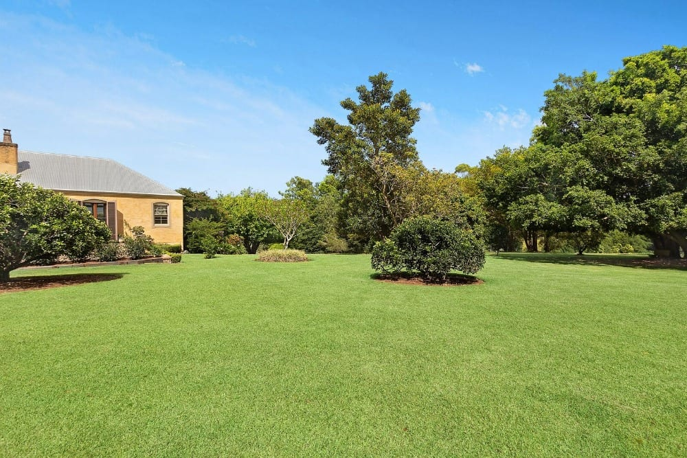 Another look at the home's massive and wide lawn area, perfectly-maintained. Images courtesy of Toptenrealestatedeals.com.
