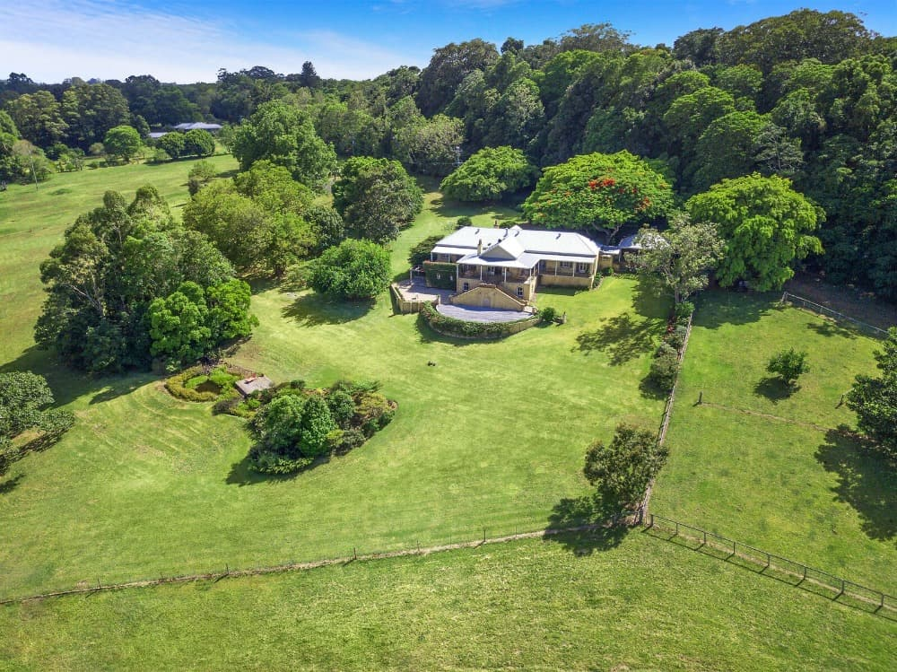 Aerial view of the property boasting its massive and wide lawns along with the healthy trees surrounding it. Images courtesy of Toptenrealestatedeals.com.