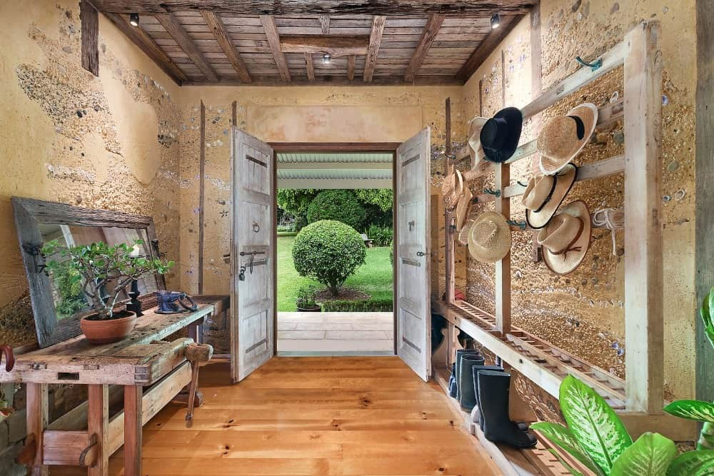 A mudroom entry featuring hardwood flooring and a rustic ceiling. Images courtesy of Toptenrealestatedeals.com.