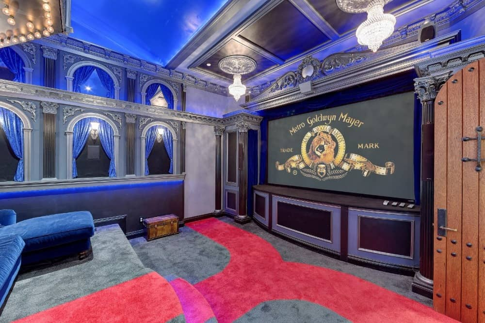 There's a beautifully-designed home theater as well featuring sectional couches and nice carpeted flooring. Images courtesy of Toptenrealestatedeals.com.