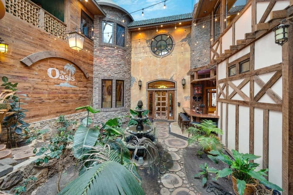 Another look at the home's indoor garden featuring healthy greenery. Images courtesy of Toptenrealestatedeals.com.