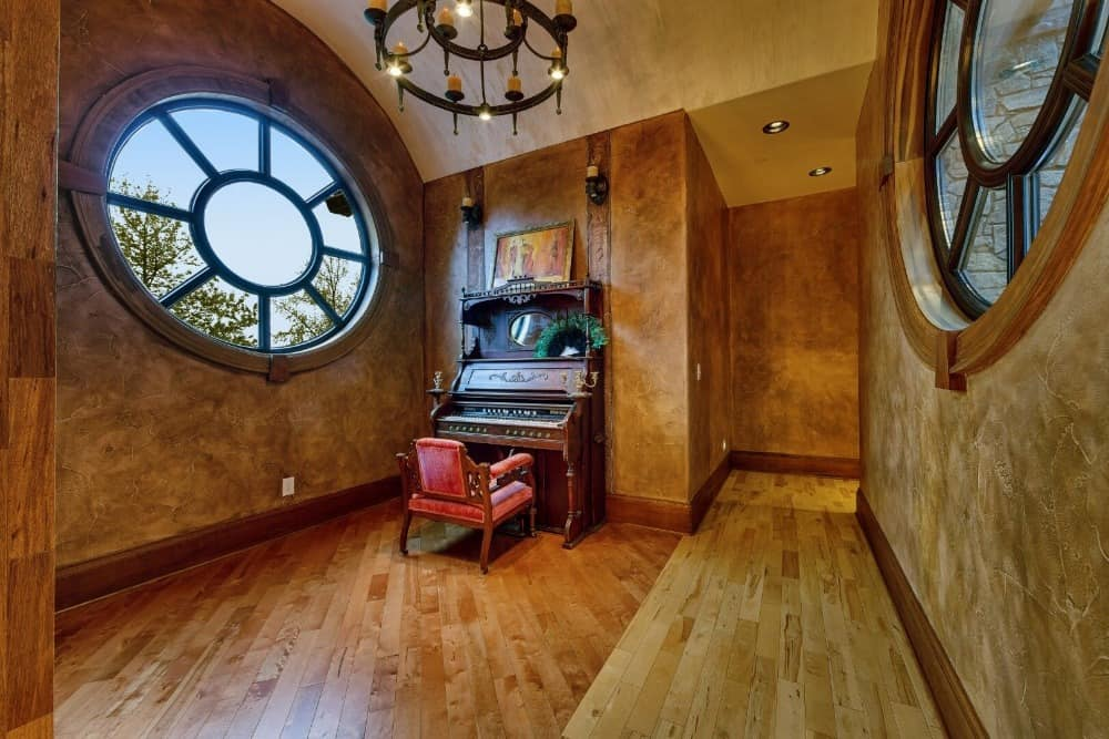 This hallway features a vintage piano on the side along with a gorgeous window. Images courtesy of Toptenrealestatedeals.com.