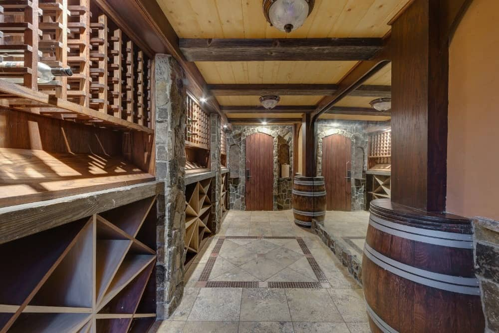 There's a wine cellar in the home as well, boasting multiple wine racks that can store hundreds of bottles. Images courtesy of Toptenrealestatedeals.com.