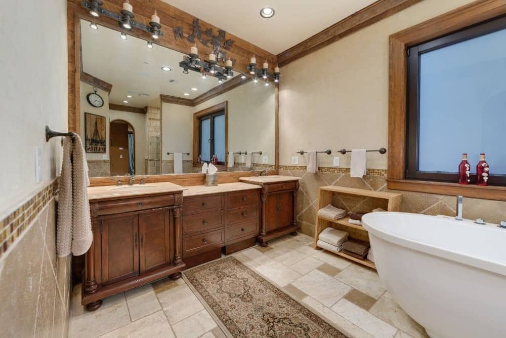 Another look at this bathroom showcasing its double sink counter and the large freestanding deep soaking tub. Images courtesy of Toptenrealestatedeals.com.