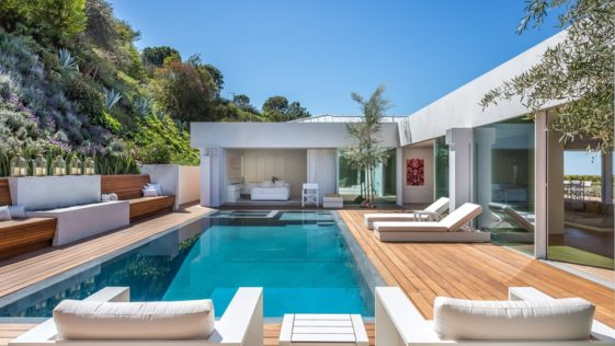 The centerpiece of the backyard is the beautiful zero-edge pool that is surrounded by charming wooden walkways augmented by comfortable sitting areas perfect for a relaxing day by the pool. Images courtesy of Toptenrealestatedeals.com.