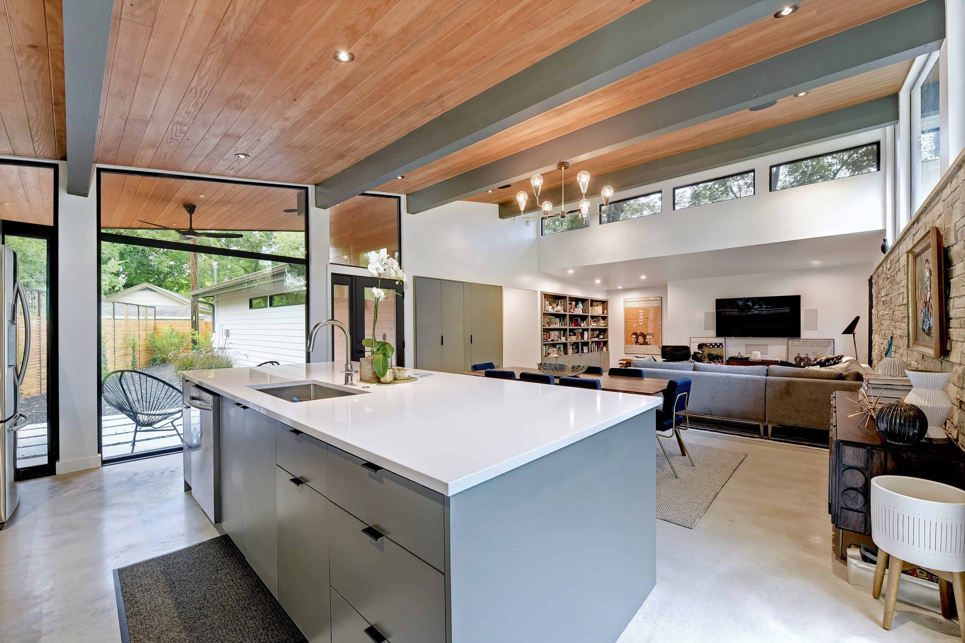 Kitchen, dining and living space in the Re-Open House designed by Matt Fajkus Architecture.