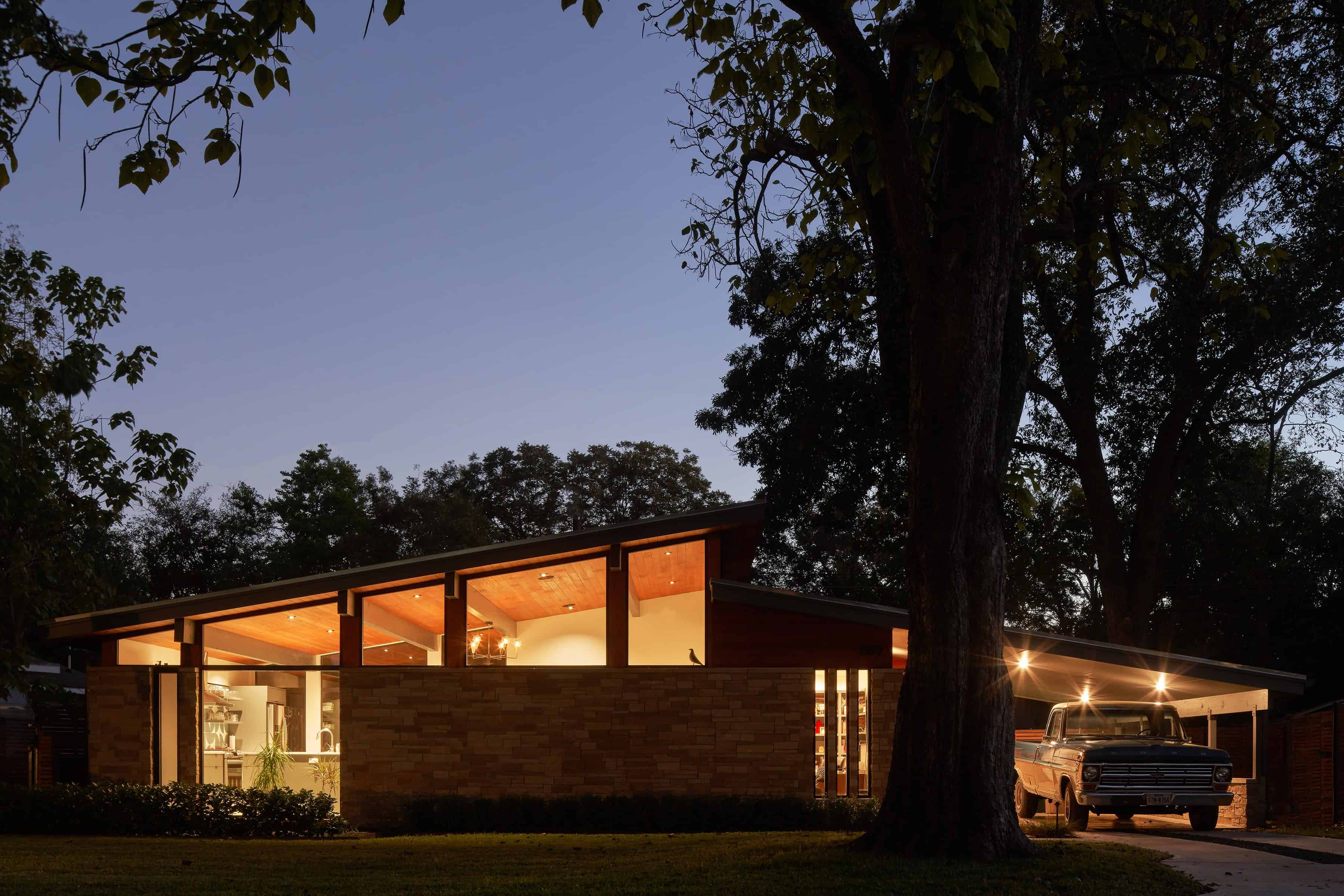 House exterior at night of the Re-Open House designed by Matt Fajkus Architecture.