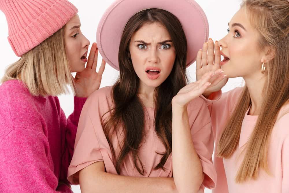 Three young women gossiping.