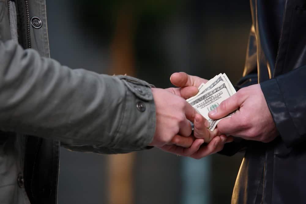 Money being exchanged between two individuals.