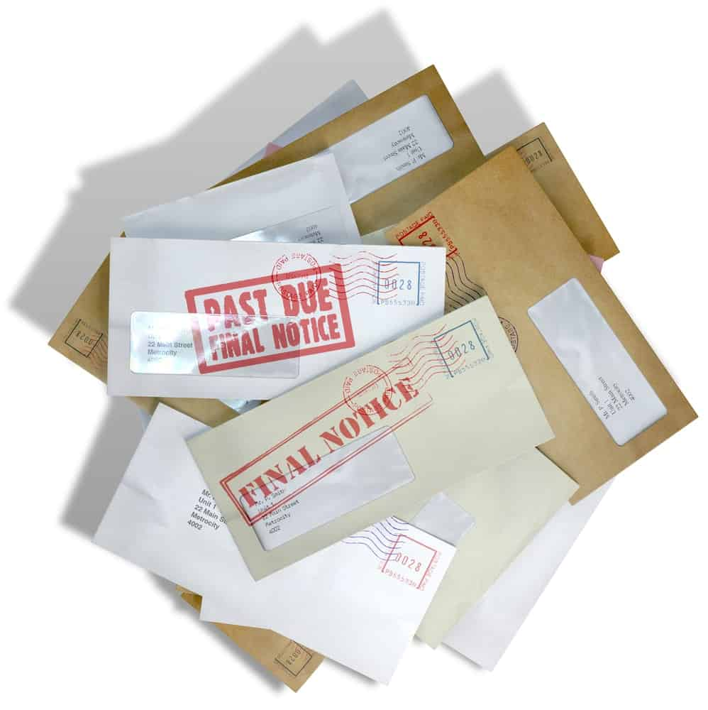 A mail stack of bills and final notices.