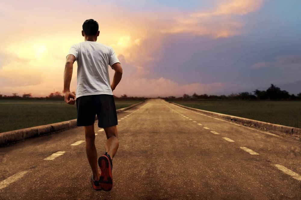 A man running on an unending road.