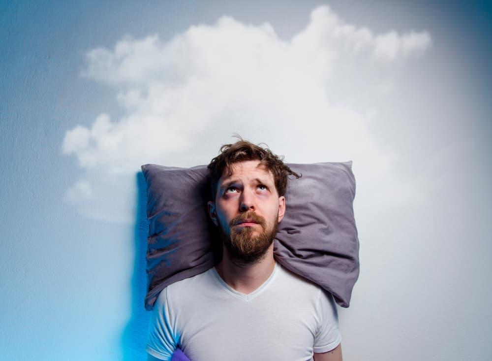 A man having sleeping problems.