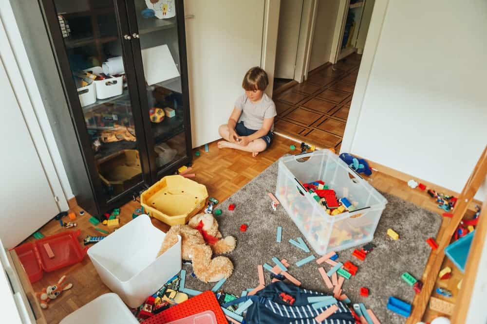 A messy and cluttered child's playroom.