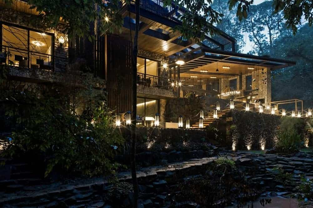 Large contemporary and luxurious house with a stunning exterior design and has lovely outdoor and indoor lighting.