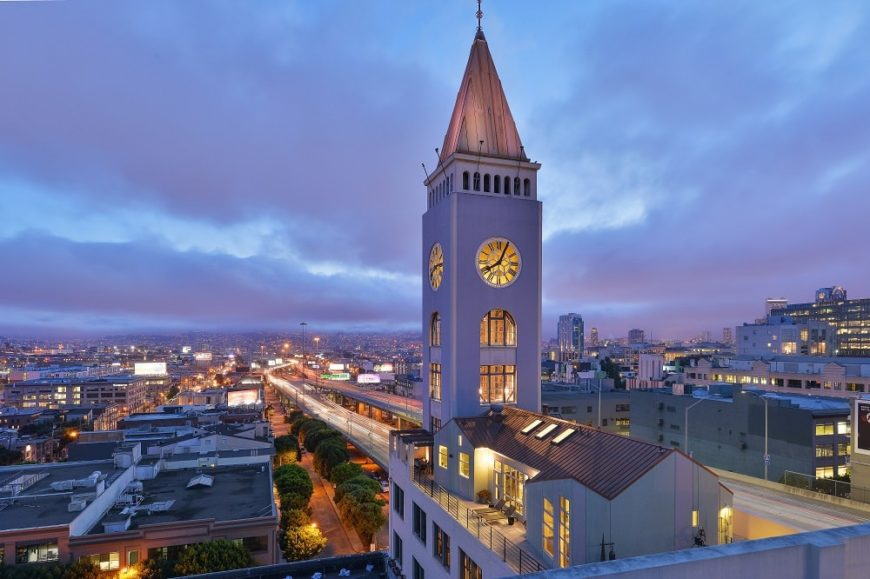 Aerial view of the clock tower penthouse at night featuring its warm yellow lights along with the amazing view of the city. Images courtesy of Toptenrealestatedeals.com.