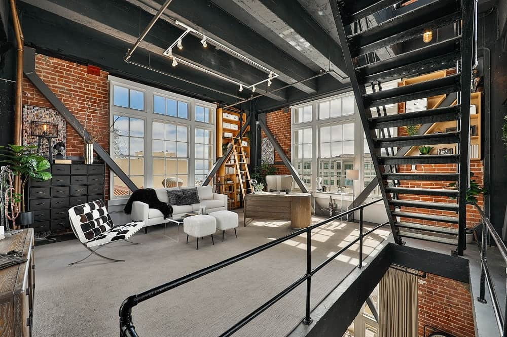 The view from the metal stairs shows that the home office is brightened by the surrounding floor-to-ceiling windows. Images courtesy of Toptenrealestatedeals.com.