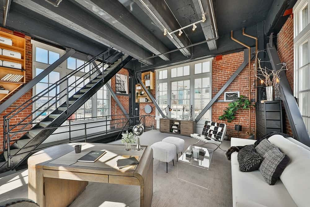 The industrial-style beauty of the dark gray metal beams of the ceiling is a perfect pairing for its tall red brick walls. Images courtesy of Toptenrealestatedeals.com.