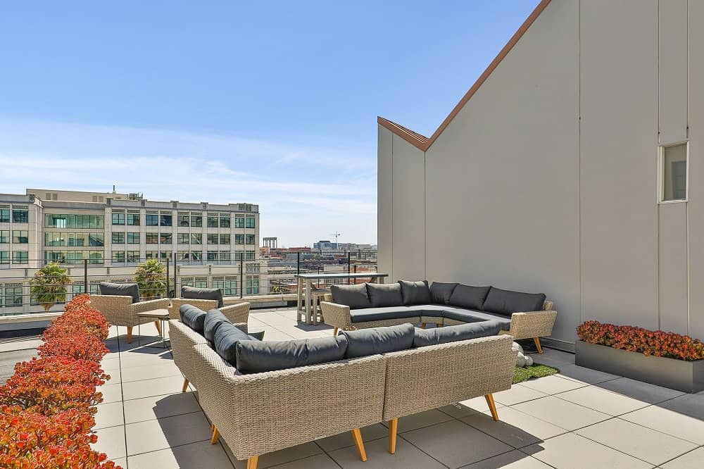 The large deck area is fitted with a couple of large L-shaped sectional sofas perfect for parties. Images courtesy of Toptenrealestatedeals.com.