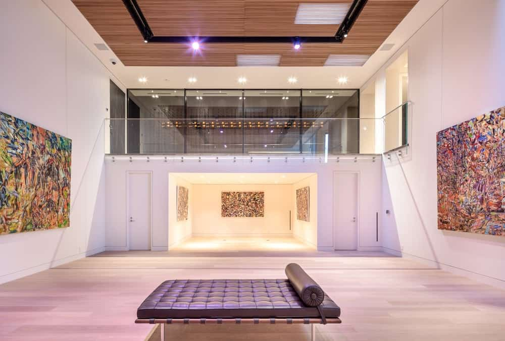 The large subterranean art gallery has an immense floor space with a single cushioned day-bed in the middle to sit and enjoy the art. Images courtesy of Toptenrealestatedeals.com.