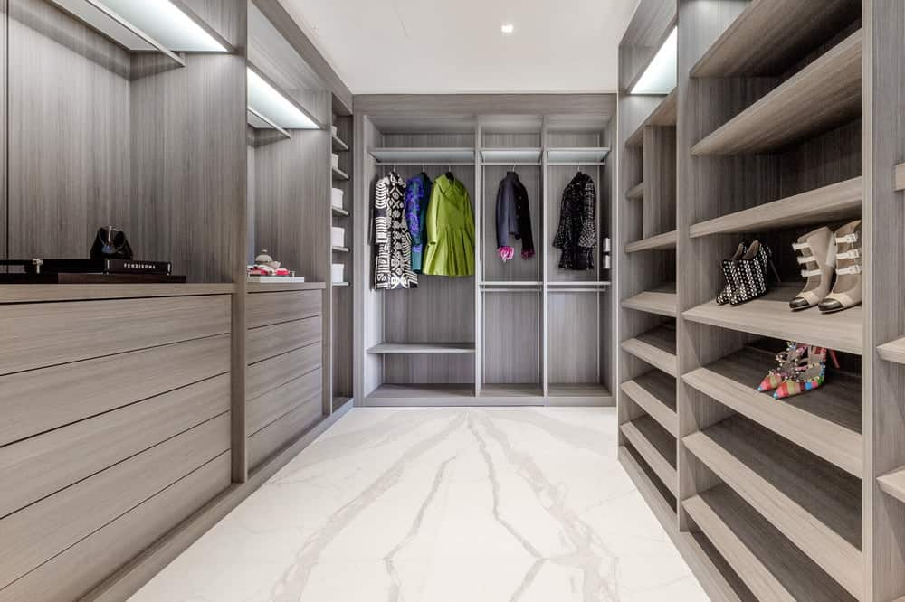 The walk-in closet has a large space complemented by the wooden cabinets and shelves lining the walls enough for a large fashion collection. Images courtesy of Toptenrealestatedeals.com.