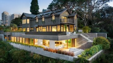 This gorgeous mansion is seen from a great vantage point showing the two sections of the house. The more traditional upper floors and the modern lower levels both warmly lit with a welcoming yellow light that gives it warmth and a homey feeling. Images courtesy of Toptenrealestatedeals.com.