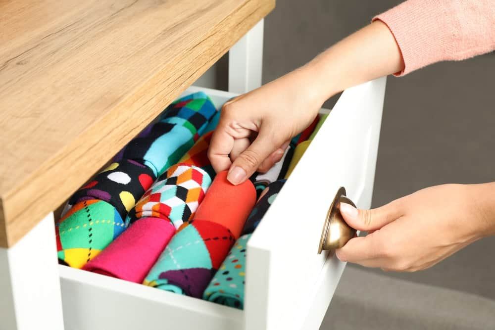 A sock drawer filled with neat and organized colorful socks.