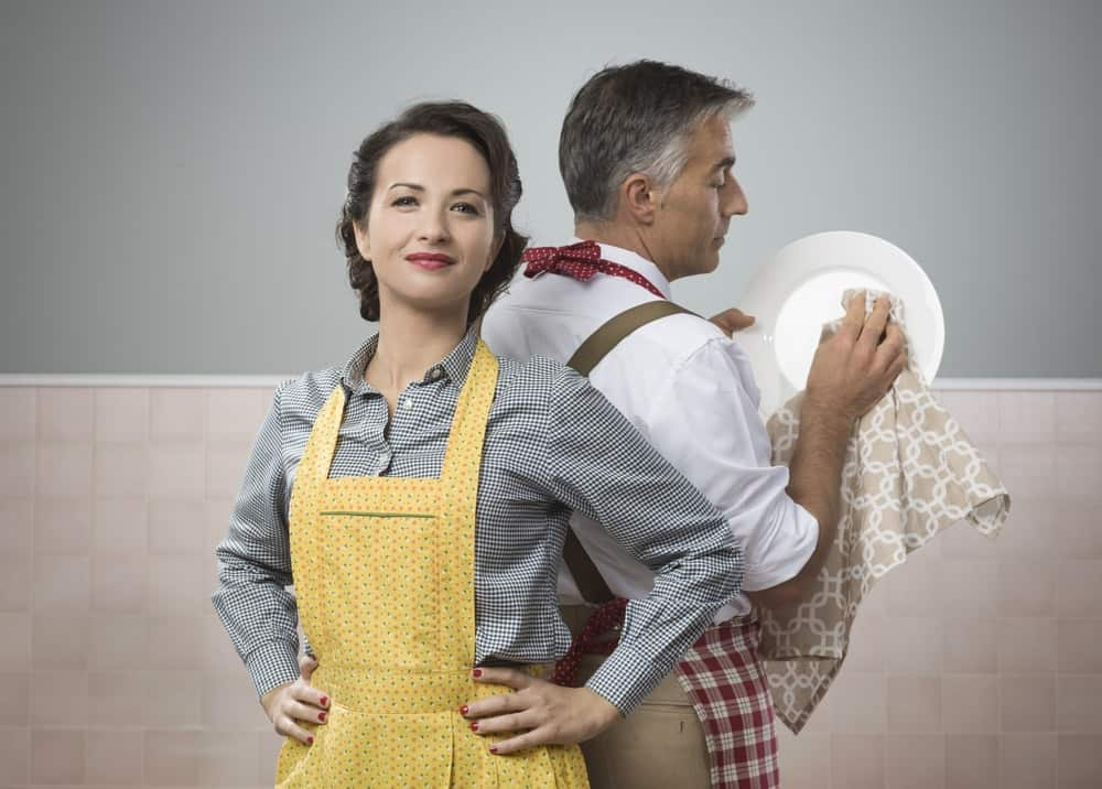 A husband helping his wife with the dishes.