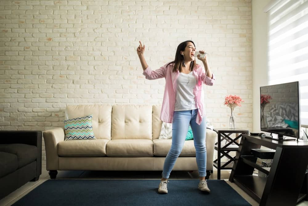 A woman enjoying herself in her living room.