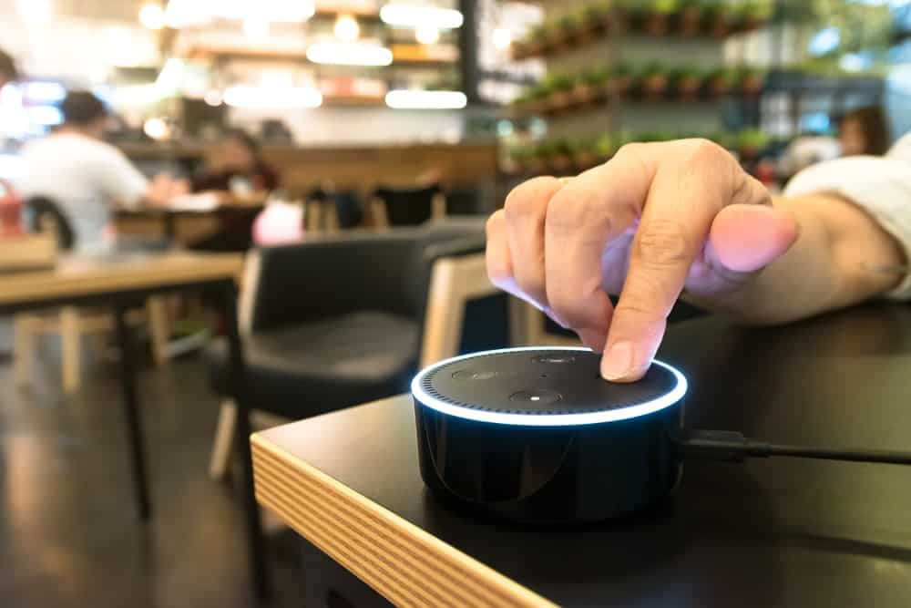 An electronic gadget being used while in a cafe.