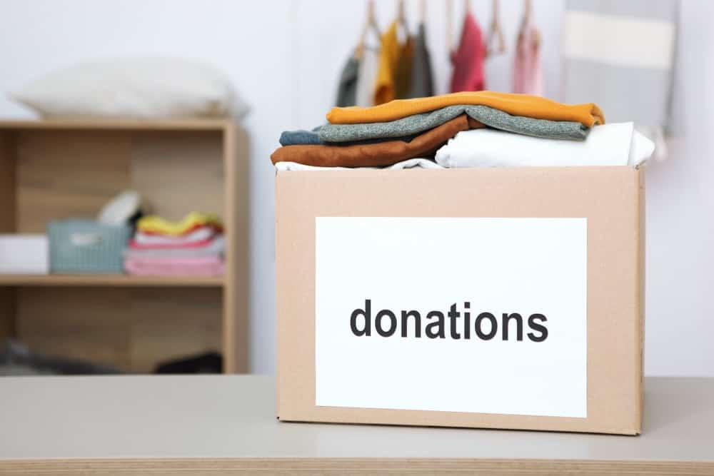 A cardboard box filled with donations.