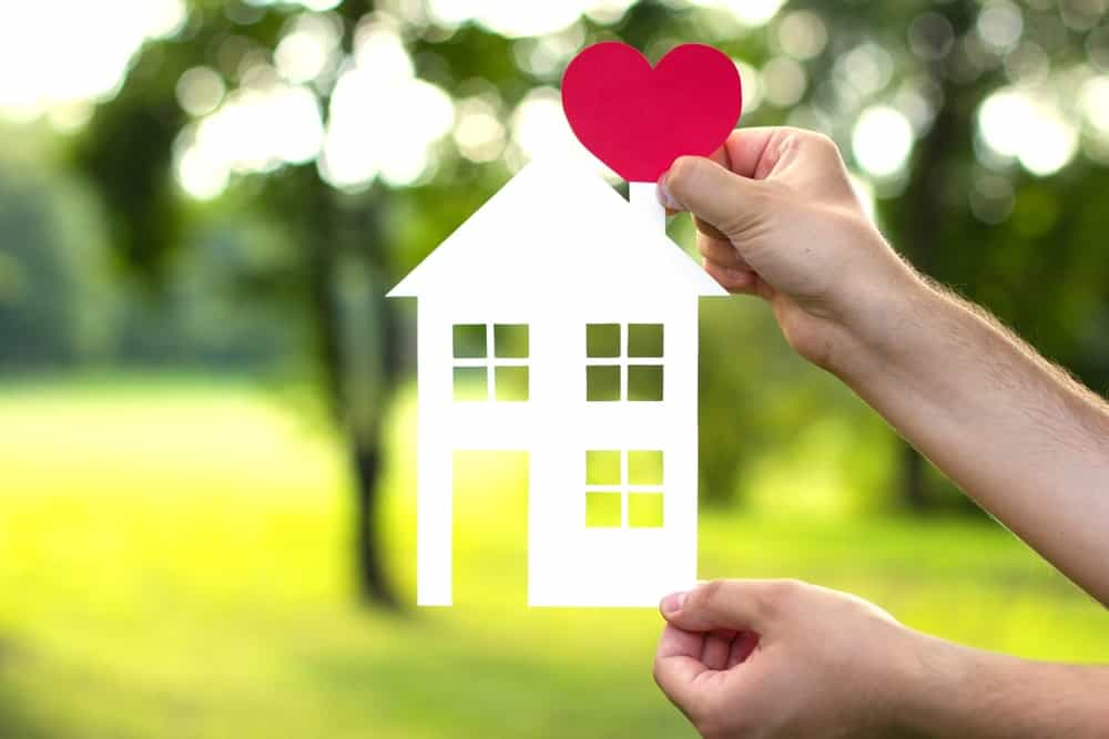 A paper cut-out visual representation of someone's love for his/her house.