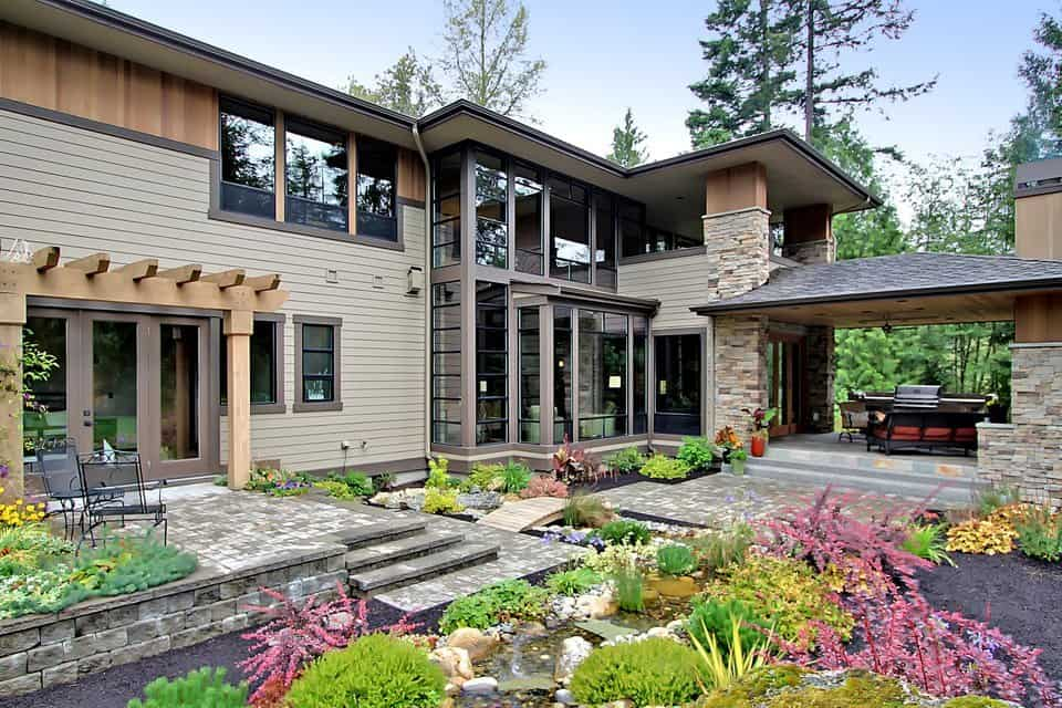 Rear view of the house showcasing an enchanting garden and a terrace outside the guest suite.