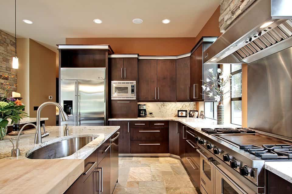 Closer view of the kitchen shows the dark wood cabinetry and state-of-the-art appliances.