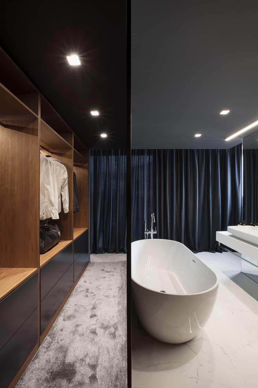 Walk-in closet and primary bathroom in the SPV29 designed by ALL In STUDIO LTD.